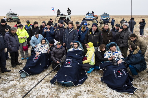 U.S. astronaut Kelly and Russian cosmonauts Volkov and Korniyenko rest after landing near Dzhezkazgan