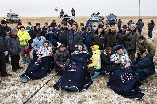 U.S. astronaut Kelly and Russian cosmonauts Volkov and Korniyenko rest after landing near Dzhezkazgan