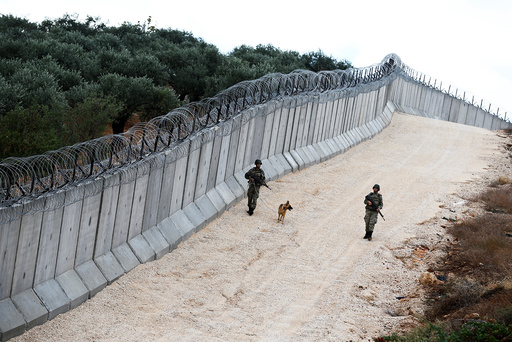 A K9 unit patrol along a wall on the border line between Turkey and Syria, near the southeastern village of Besarslan in Hatay province