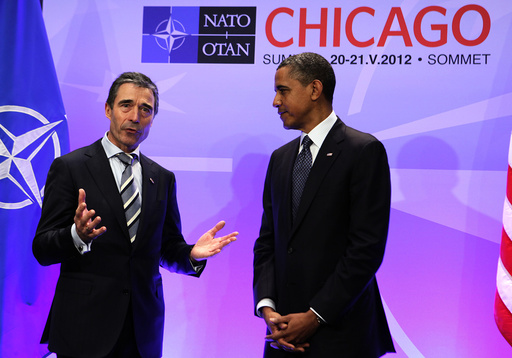 U.S. President Barack Obama listens to NATO Secretary General Rasmussen in Chicago