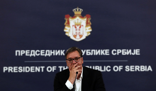 """Serbia's President Aleksandar Vucic listens to a question during a press conference in Belgrade, Serbia, Tuesday, July 7, 2020. Serbia's president has announced the reintroduction of a curfew in Serbia after the highest single-day spike in deaths from the coronavirus. Vucic on Tuesday described the virus situation in Belgrade as """"alarming"""" as hospitals in the capital are leaching their limits. (AP Photo/Darko Vojinovic)"""