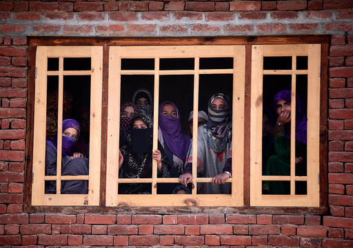 Women watch the funeral of Rayees Ahmad Wani, a suspected militant who according to local media was killed in Padgampora in an encounter with the Indian security forces on Sunday, in Bellow village in south Kashmir