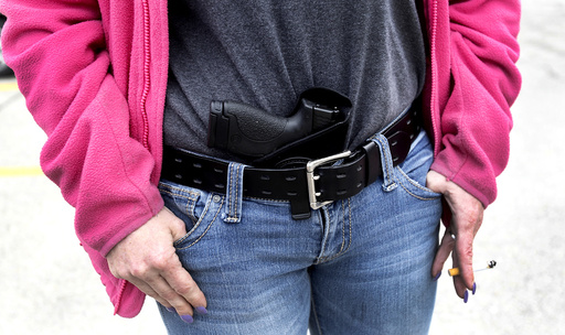 Gloria Lincoln-Thompson carries her 9mm Smith & Wesson pistol in her waist band during a rally in support of the Michigan Open Carry gun law in Romulus, Michigan