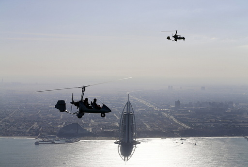 Gyrocopters fly over Dubai during the World Air Games 2015