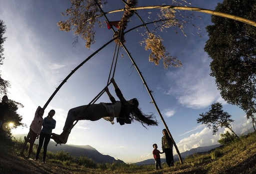 Spending time on bamboo swings in Kathmandu