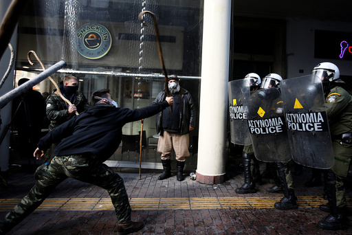 Farmers from the island of Crete clash with riot police during a demonstration outside the Agriculture Ministry in Athens