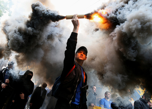 Members of the Ukrainian national guard Azov regiment and activists of the Azov civil corp take part in a protest against local elections in pro-Russian rebel-held areas of eastern Ukraine in Kiev
