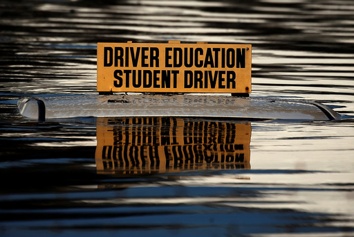 The roof a student driver car is pictured partly underwater as a result of Hurricane Matthew in Lumberton