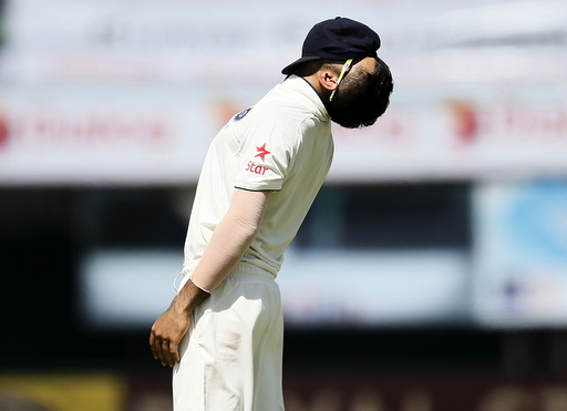India's captain Kohli reacts after his teammate Rahul missed a catch hit by Sri Lanka's captain Mathews during the third day of their second test cricket match in Colombo