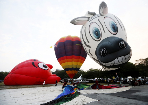 Balloons are inflated during the Hot Air Balloon festival in Putrajaya
