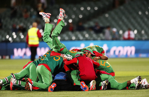 Bangladesh's Nassir Hossain leaps onto team mates in celebration after Bangladesh knocked England out of the tournament in their Cricket World Cup match in Adelaide