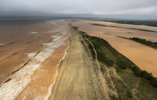 A general view the sea and Rio Doce, which was flooded with mud after a dam owned by Vale SA and BHP Billiton Ltd burst, as the river joins the sea on the coast of Espirito Santo in Povoacao Village