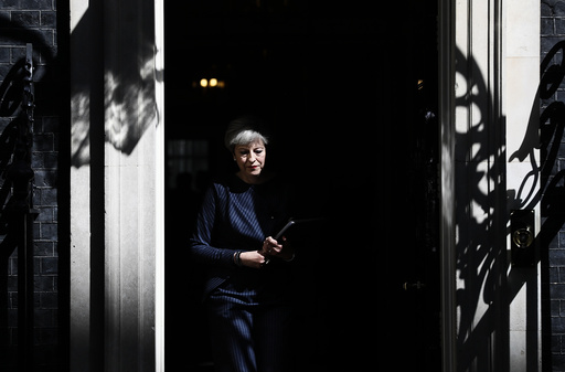 Britain's Prime Minister Theresa May prepares to speak to the media outside 10 Downing Street, in central London