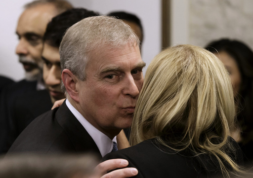 Britain's Prince Andrew greets a business leader during a reception at the sideline of the World Economic Forum in Davos