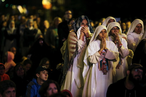Nuns watch Pope Francis' speech on a screen during the Festival of Families rally along Benjamin Franklin Parkway in Philadelphia, Pennsylvania
