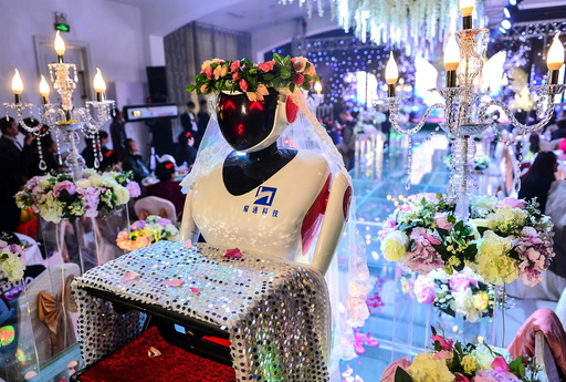 A robot dressed up as a bridesmaid serves at a wedding in Tianjin