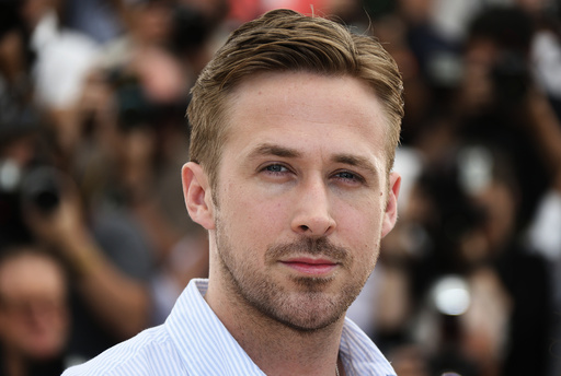 Director Ryan Gosling poses during a photocall for the film