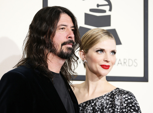 Dave Grohl and his wife Jordyn arrive at the 58th Grammy Awards in Los Angeles