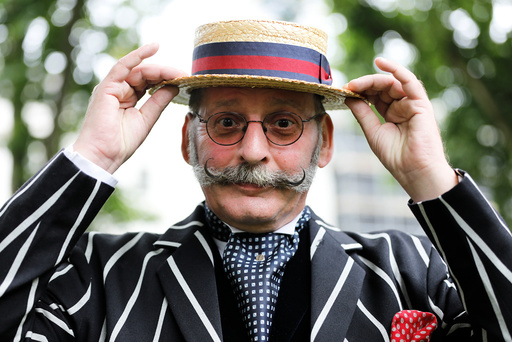 A participant poses for a photograph during the Chap Olympiad in Bedford Square, London