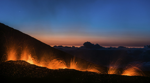 Molten lava erupts from the Piton de la Fournaise, one of the world's most active volcanoes on the Indian Ocean Reunion Island