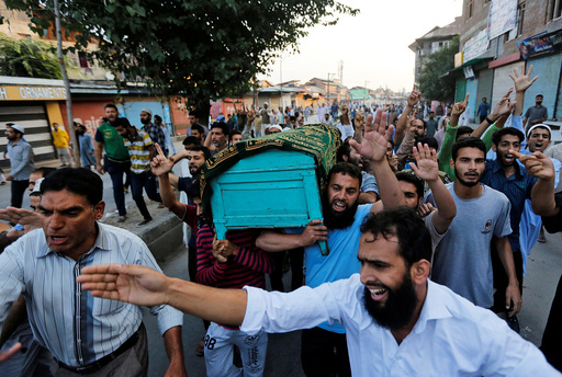 Kashmiri men carry a coffin containing the body of Abdul Qayoom during his funeral in Srinagar