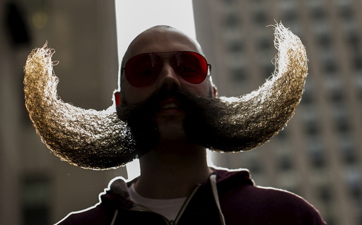 MJ Johnson gathers with other contestants to promote the National Beard and Moustache Championships in New York