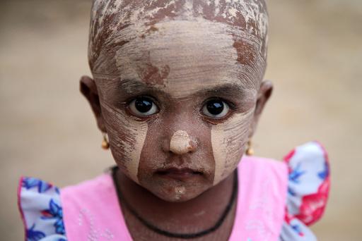 A girl wears thanakha powder on her face in a Rohingya refugee camp outside Kyaukpyu in Rakhine state, Myanmar