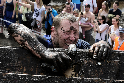 A man competes during 'The Strong Race' in Kegums