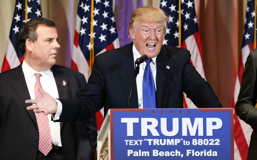 Republican U.S. presidential candidate Trump with former rival candidate Christie at his side speaks about the results of Super Tuesday primary and caucus voting during a news conference in Palm Beach