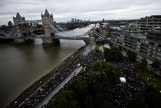 People attend a vigil to remember the victims of the attack on London Bridge and Borough Market, at Potters Field Park, in central London