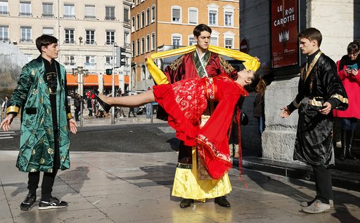 Illusionist Guillaume Arribart, performs on the street to demonstrate the levitation of an assistant to promote his show in central Lyon