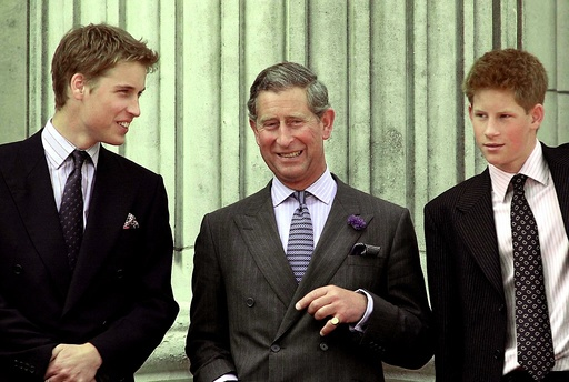 PRINCE CHARLES SMILES AS HE STANDS WITH HIS TWO SONS AT BUCKINGHAM PALACE