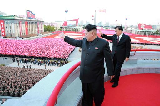 KCNA picture of North Korean leader Kim Jong Un and senior Chinese Communist Party official Liu Yunshan attending celebrations of the 70th anniversary of the founding of the ruling Workers' Party of Korea