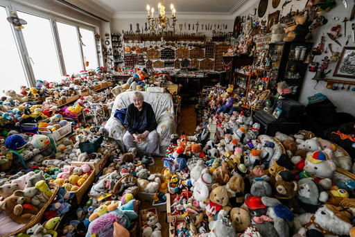 Belgian Catherine Bloemen, 86, sits among more than 20,000 stuffed and plastic toys, she is collecting for more than 65 years, in her house in Brussels