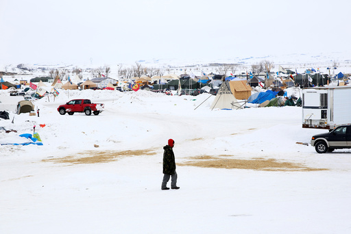 A man walks through the Dakota Access Pipeline protest camp on the edge of the Standing Rock Sioux Reservation near Cannon Ball