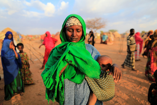 An internally displaced woman from drought hit area reacts after she complains about the lack of food at makeshift settlement area in Dollow, Somalia