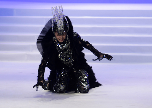 A model falls while presenting a creation during China Fashion Week in Beijing