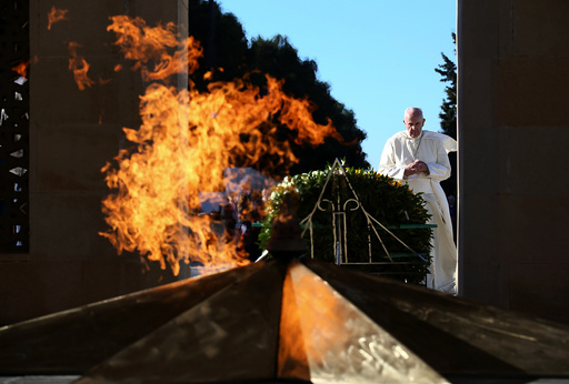 Pope Francis prays in front of the Azerbaijan Baku City Shadhidlar Hiyabani Monument to the Fallen Heroes in Baku