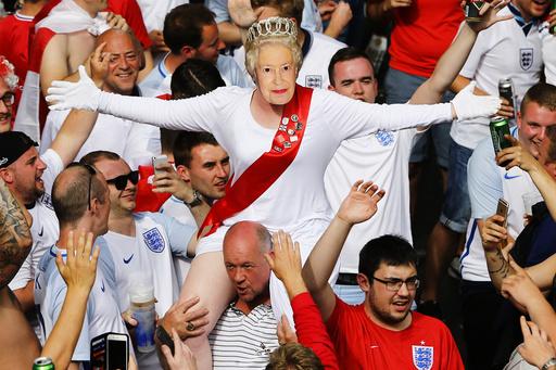 England fan wears mask of Queen Elizabeth II in Saint Etienne - EURO 2016