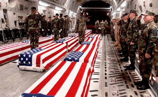 UNDATED PHOTO OF US MILITARY COFFINS BEING OFFLOADED AT DOVER AIR FORCE BASE