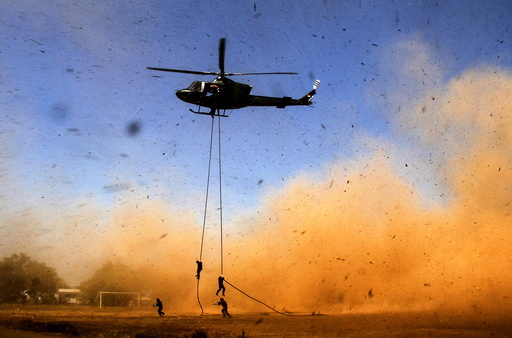 Yonif 700/Raider soldiers descend from a helicopter using a rope during a counter-terrorism drill in Makassar