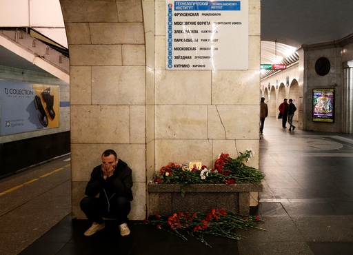 A man reacts next to a memorial site for the victims of a blast in St. Petersburg metro, at Tekhnologicheskiy institut metro station in St. Petersburg