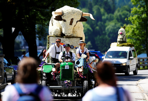 A figure made of daffodil blossoms arrives for a parade during the daffodil festival along Grundlsee lake in Grundlsee