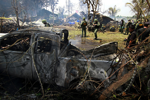 Thai EOD personnel inspect the site of a bomb attack where police officers were injured, at Nong Chik district in the troubled southern province of Pattani