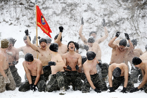 South Korean and U.S. Marines hurl snow during a winter military drill in Pyeongchang