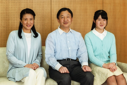 Japan's Crown Prince Naruhito poses for a photo with Crown Princess Masako and their daughter Princess Aiko at Togu Palace in Tokyo