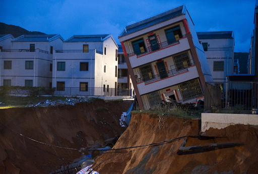 Damaged house is seen after a heavy rainfall caused by Typhoon Vamco hit Lingshui Ethnic Li Autonomous County, in Hainan