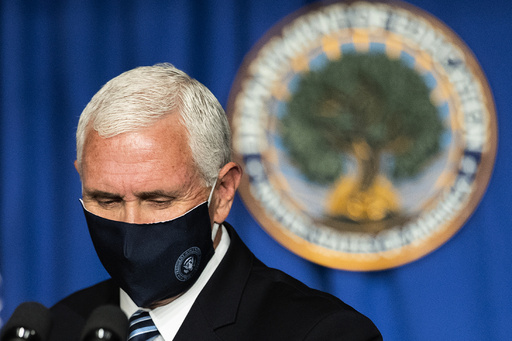 Vice President Mike Pence concludes a White House coronavirus task force briefing at the Department of Education building Wednesday, July 8, 2020, in Washington. (AP Photo/Manuel Balce Ceneta)