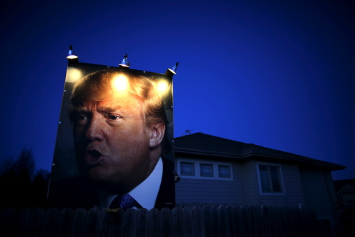 A picture of U.S. Republican presidential candidate Donald Trump hangs outside a house in West Des Moines