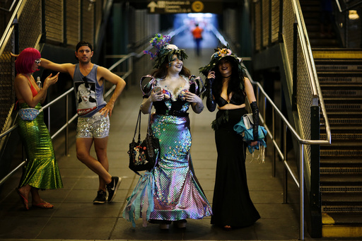 Participants of the Mermaid Parade arrive in a subway station in Brooklyn, New York